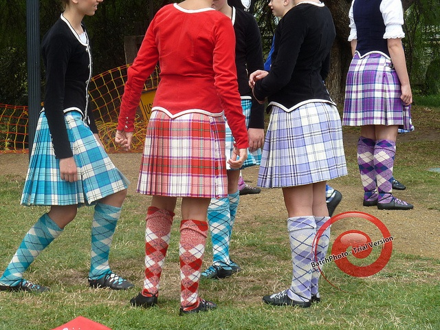 P1050852 by chrispbin, via Flickr  Second from right - kilt with black jacket from the back #harris #purple #tartan
