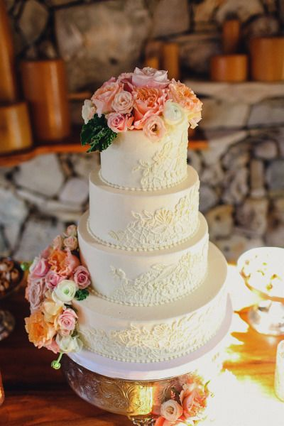 Lace and rose decorated cake: http://www.stylemepretty.com/texas-weddings/austin/2014/05/01/rustic-wild-onion-ranch-wedding/ | Photography: Christina Caroll - http://christinacarrollphotography.com