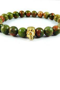 Dizarro to męska biżuteria najwyższej jakości produkowana z kamieni półszlachetnych, srebra, złota oraz kryształów Swarovski™.  Bransoletka wykonana z jaspisów oraz czaszki pokrytej 23-karatowym, złotem. Szczegóły:- czaszka pokryta 23-karatowym, włoskim złotem- bransoletka wkładana na elastycznej gumce- średnica kulek: 8 mm- bransoletka zapakowana w eleganckie, czarne pudełko