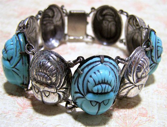 Vintage Art Deco silver plate and glass scarab bracelet Large turquoise blue glass scarabs alternate with repousse silver plate scarabs 7 1/4 inches long, 1 inch wide Blue ... #gotvintage #jewellery