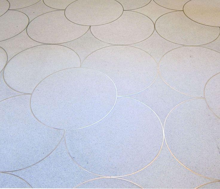 Steel Cut Rings embedded into concrete floors. Neat idea but I would like a herringbone pattern