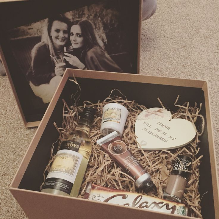 Rustic - Will you be my bridesmaid box. Brown box, shredded paper, white wine, yankee candle, body shop hand cream, galaxy chocolate, nail varnish and wooden heart. Photograph in lid.