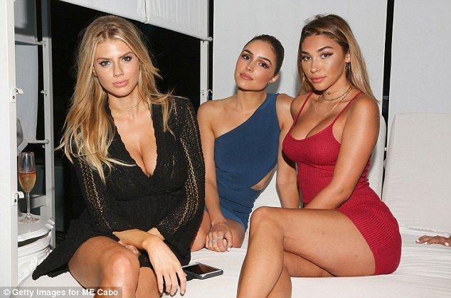 Leggy: All three girls showed off their bronzed figures in mini dresses...