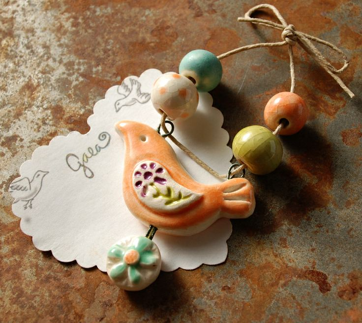 Thesehand picked, love and skytone, artisan made ceramic beads and one Peace Bird bracelet bar are hand formed, hand carved and an original design!