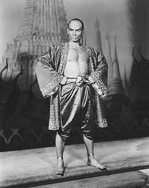 Yul Brynner, The King and I, 1954, public domain via Wikimedia Commons.
