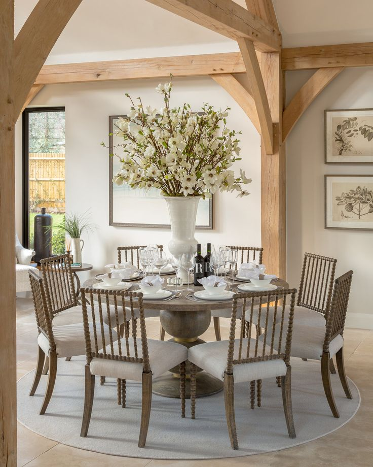 Traditional yet contemporary, these elegant bobbin chairs and dining table by Julian Chichester rest serenely beneath the high-vaulted oak beams of our rustic Surrey barn project. With ivory tones, this design is fresh, light and ethereal in its tranquility.