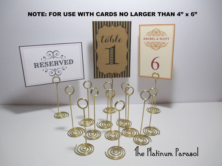 """ANTIQUE GOLD Ring Style Table Number Stand, Card Holder. Wedding Table Stands - Sign Stand, Card Holder,  4.25"""" tall.  Choose your quantity. by ThePlatinumParasol on Etsy https://www.etsy.com/listing/291440009/antique-gold-ring-style-table-number"""
