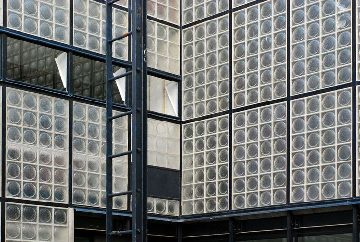 Modernist facade of the House of Glass Maison de Verre by Pierre Chareau