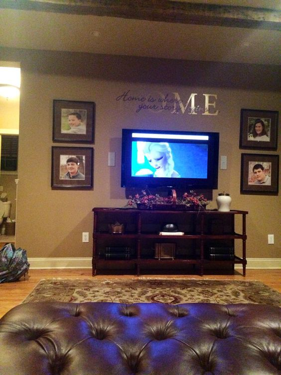 Stewart family room angle 4... love that the tv is on wall with delicate tv console. love pictures around tv and love that theres a wall decal above tv.