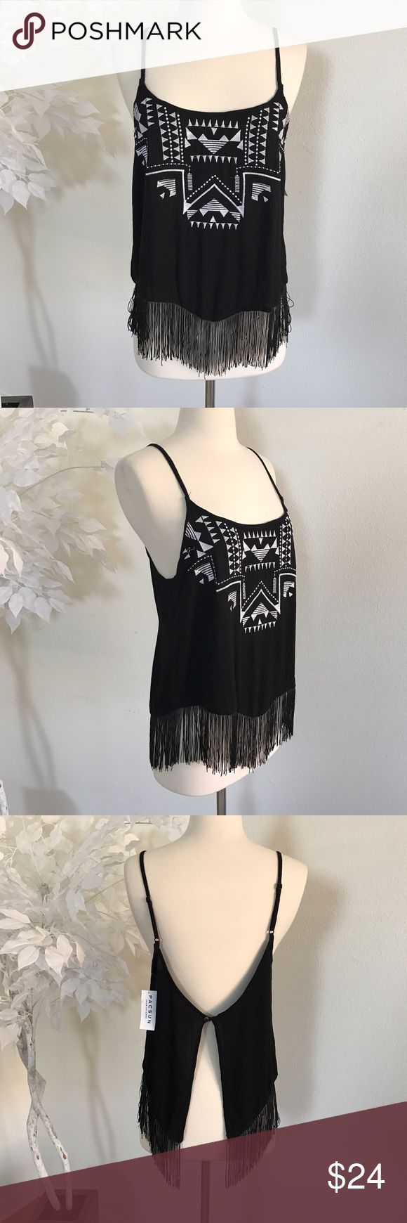 Kendall & Kylie Aztec Fringe Summer Top🖤 Kendall & Kylie Aztec Fringe Summer Top🖤 Condition: NWT Size: S Bust: 16 Length: 25 The perfect summer top, perfect for summer concerts and summer festivals.  Originally purchased at pacsun, features a very nice open back and fringes! Grab this beauty while you can 😄🌴   In Bin: PT **Comes from a SMOKE FREE 🏡 Home** Kendall & Kylie Tops Tank Tops