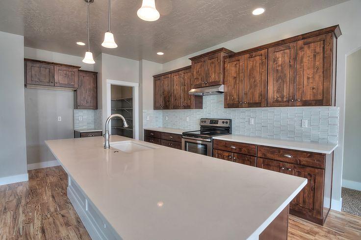 Whitman Maple Kitchen Cabinets, Oak Verona Andalusia Hardwood Floor,  Morello Linear Moonstone Full Backsplash, And Morning Frost Engineered  Stone.