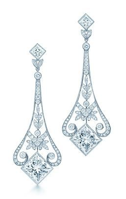 Tiffany has designed chandelier earrings since the great society balls of the late 19th century. Garland-style earrings of two princess-cut diamonds set on the bias with round brilliant diamonds in platinum, for pierced ears. Princess-cut diamonds, carat weight 4.02 each, color grade G, clarity grade VS2; round brilliant diamonds, carat total weight .96.
