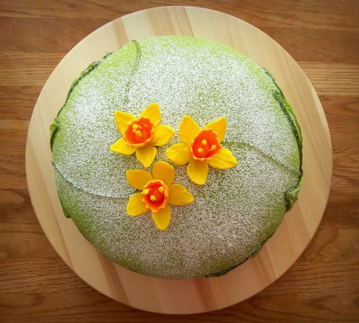 Easter themed Swedish Princess Cake - Marzipan covered and filled with sponge cake, cream, raspberries and vanilla custard