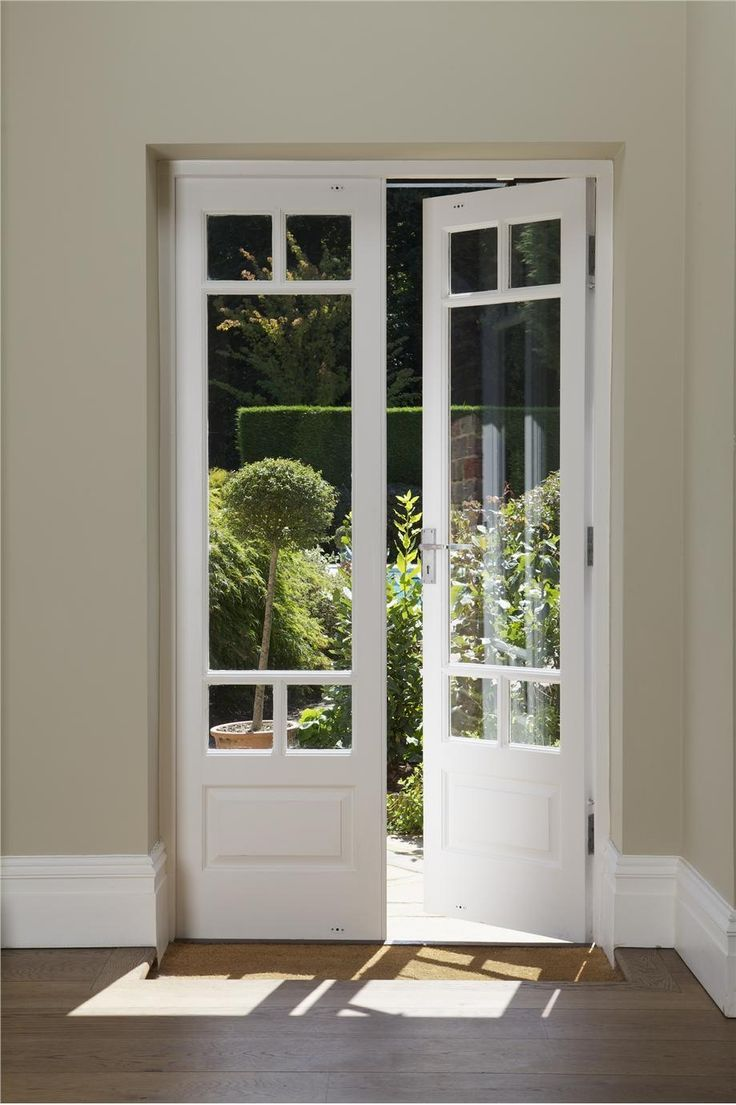 Door outside ex le of a trendy white tile bathroom for French door style patio doors