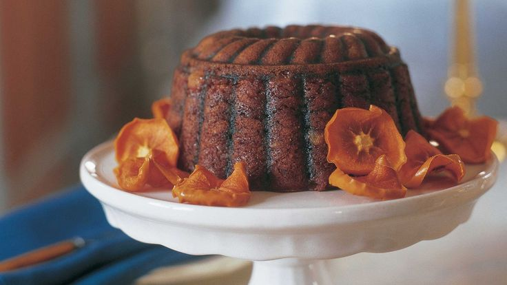 Two kinds of persimmons are recruited for steamed pudding; soft, ripe hachiyas are used in the batter, and oven-dried slices of fuyu -- resembling orange flowers -- form a ring around the dessert. The pudding is full of golden raisins, pecans, and candied ginger and warmed by brandy's sweet heat.