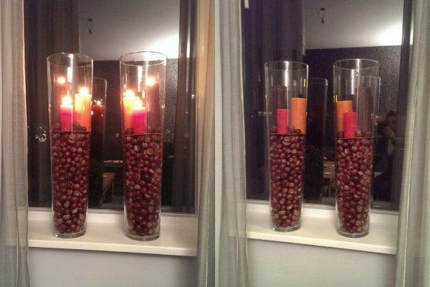 Hoge glazen potten met kastanjes en kaarsen er bovenop! Door LBS