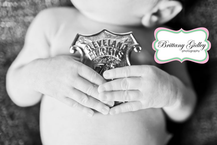 This would be cute!! Holding Daddy's badge!!