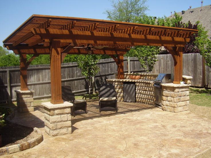 Pergola with built in bbq nice outdoor seating area too for Outdoor kitchen pergola ideas