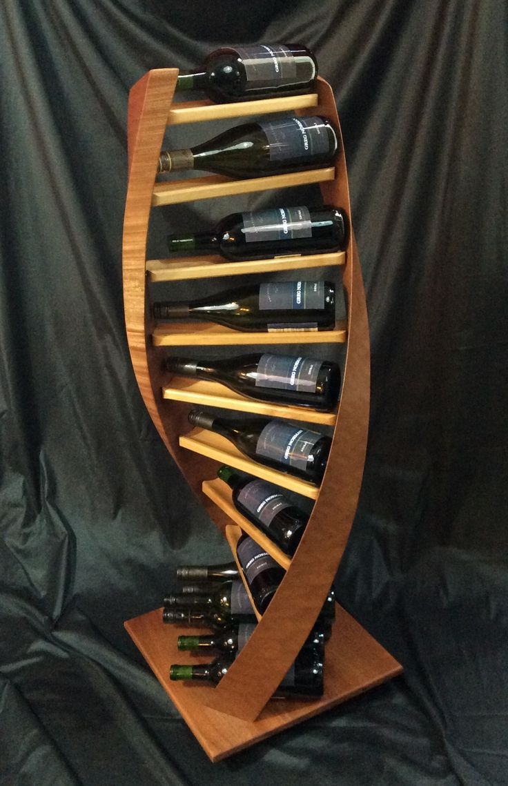 A four foot tall, double-helix inspired wine rack that shows wine the way it should be.