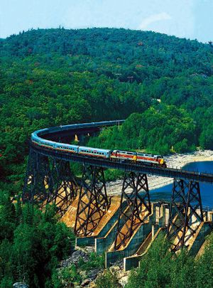 "Agawa Canyon Tour Trains , Sault Ste. Marie, Ontario Canada,  2 hour stay once you arrive, lakes on each side with every ""S"" the train makes, water falls, hiking trails, gift center, brown paper bag lunch, fun, fun, fun, and BEAUTIFUL   ..rh"