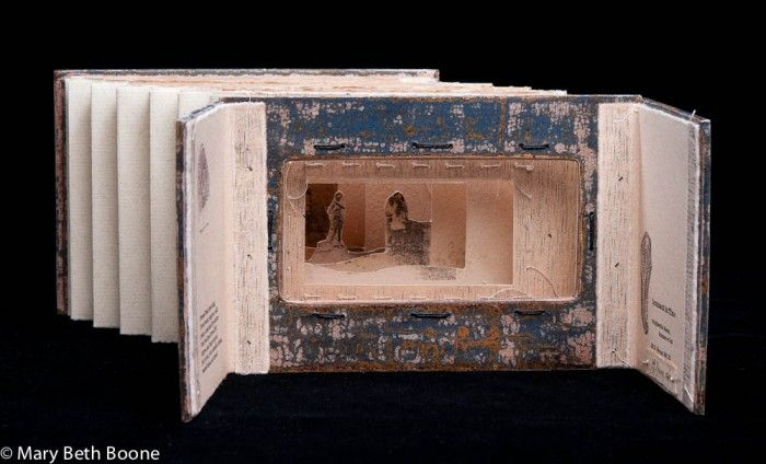 Remnant in Time, a tunnel book by Mary Beth Boone. Tunnel books are difficult to photograph, but I tried to pick a shot of this that shows the concertina form of this book, as well as the multiple cut-outs that create the diorama-like scene that defines tunnel books.