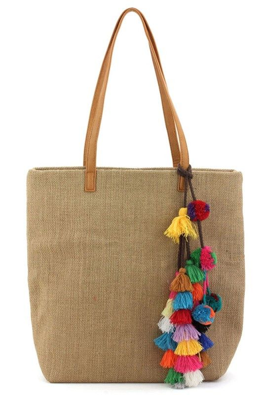 tote bag in linen material with colorful threaded pom pom and tassel details