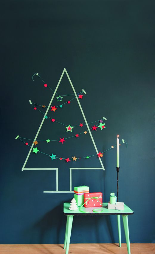 Chalkboard wall, draw a tree, decorate with shining stars garland. Neat-o! #diy #crafts #holidays