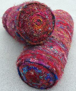 Sari Silk Bolsters I knit a tube then attached crocheted circles to each end.