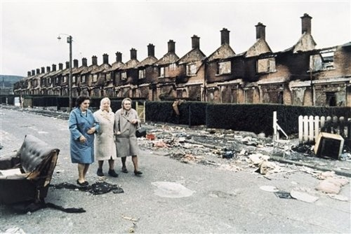 Local women walk through the rubble in Farringdon Avenue in the Ardoyne area of Belfast, Northern Ireland on Aug. 17, 1971. In the background are rows of burnt out houses set alight during a 'scorched earth' action by residents who had fled to other parts of Belfast in the wake of continuing violence.