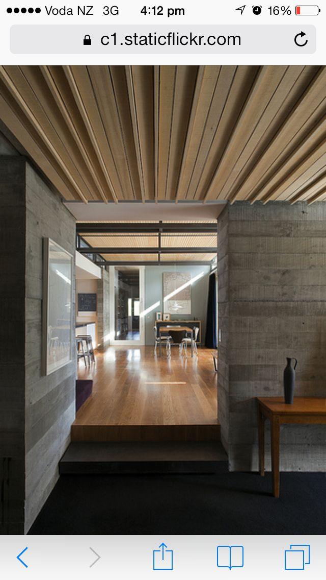 Concrete poured walls, cedar ceiling, exposed steel beams