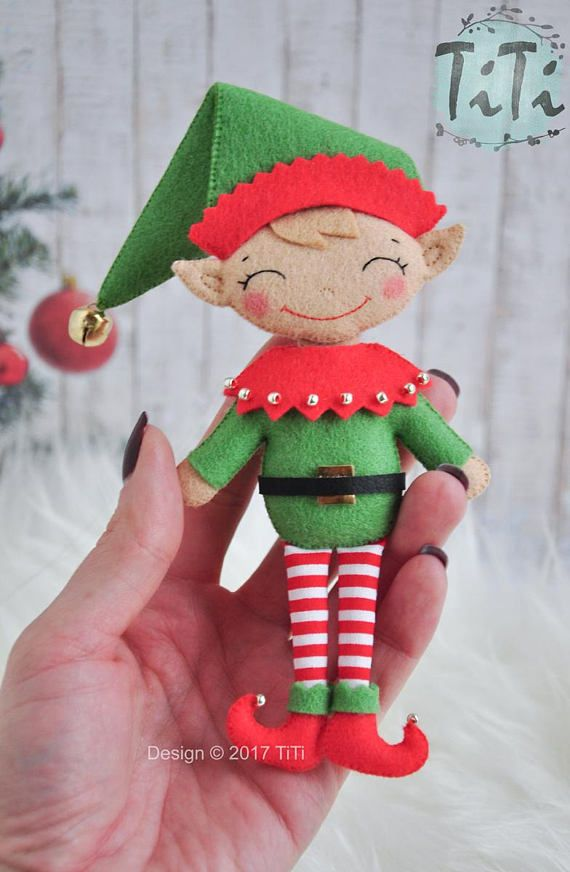 Handmade felt Christmas elf ornament. The ornament has a loop for hanging. I can to add first name to the ornament. The size of single ornament is about 16 cm (6.30 in). This is inside decor, dont use it outside. This is not a toy. It may be used only for decoration. This item contains small