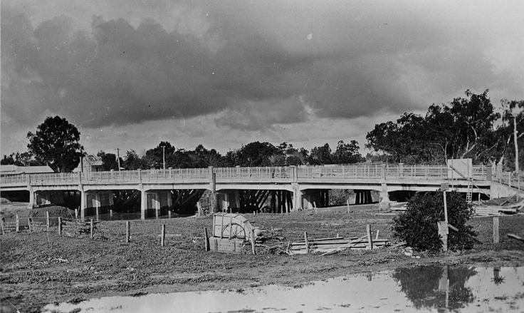 The new bridge over the Campaspe River. There is an unidentified piece of farm machinery in a paddock beside the bridge.