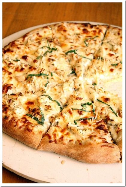 Chicken Alfredo Pizza | The Marvelous Misadventures of a Foodie  Ingredients:  To Make Alfredo Sauce 2 tablespoons butter 3 cloves minced garlic 4 ounces cream cheese, softened 1 cup skim milk 1 cup fresh grated parmesan cheese Salt & pepper Pinch of nutmeg For Pizza Assembly 1lb pizza dough 1 large (or 2 small) boneless, skinless chicken breast, cooked and shredded (about 1 ½ cups) ¾ cup shredded mozzarella cheese ¼ cup parmesan cheese Chopped fresh basil, if desired Directions: