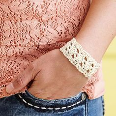 A crocheted cuff is pretty, versatile, and comfy, too! This lacy band is crocheted using perle cotton for a soft flexible fit and fastens with two small buttons on the ends.