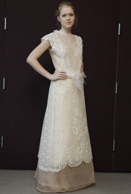 Brides.com: Pat Kerr - Spring 2013. Ivory and nude lace and organza A-line wedding dress with a high neckline and cap sleeves  See more Pat Kerr wedding dresses in our gallery.