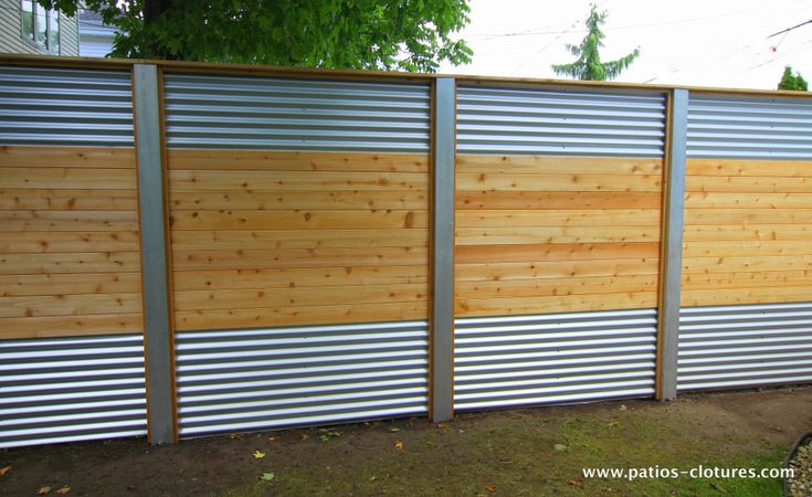 Hybrid fence with galvanized steel, aluminum and cedar Lecompte 2