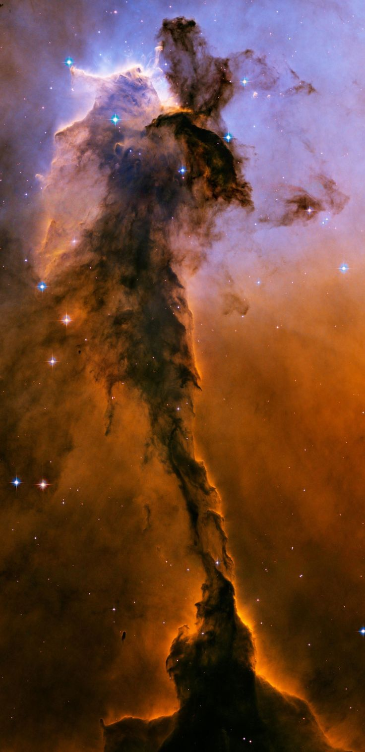 Spectacular photos from space of Eagle Nebula    Appearing like a winged fairy-tale creature poised on a pedestal, this object is actually a billowing tower of cold gas and dust rising from a stellar nursery called the Eagle Nebula.