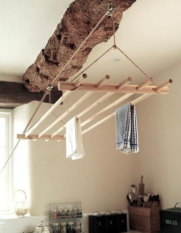 Broom handles make a cheap but classy laundry rack, much nicer than those white collapsable airers everyone uses. Love it!  Style, interior, inventive, DIY, craft, wood, kitchen, chic,