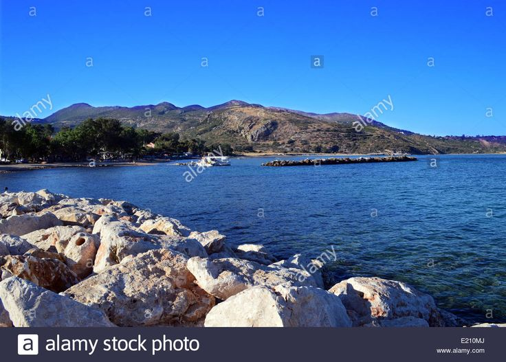 Fishing Boat Tied To Wooden Jetty In Katelios On The Greek Island Of Stock Photo, Royalty Free Image: 70093314 - Alamy