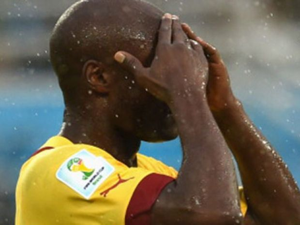 Pierre Webo of Cameroon reacts after his team's loss to Mexico.