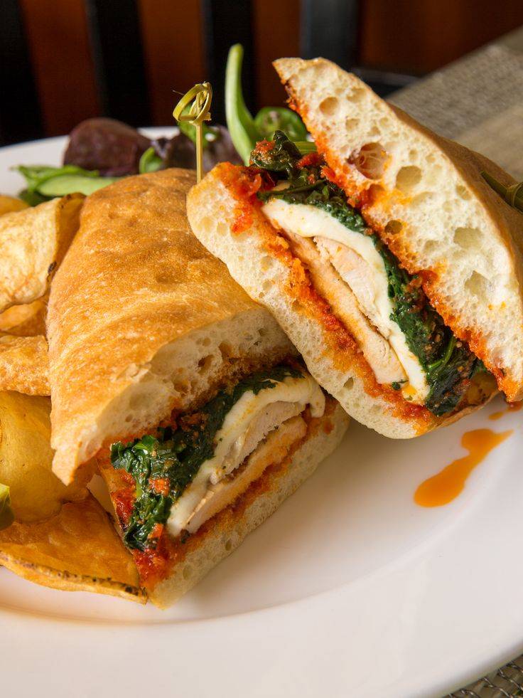 Grilled #Chicken Ciabatta with grilled chicken, sun-dried tomato pesto, sautéed spinach, and fresh mozzarella on toasted ciabatta bread