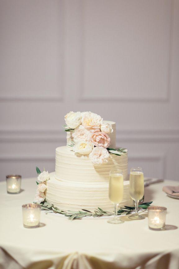 Ivory Wedding Cake With Pastel-Colored Flowers | Porto's Bakery https://www.theknot.com/marketplace/portos-bakery-glendale-ca-308830 | Bunch Studio | Zoie Events | Jennifer Fujikawa Photography https://www.theknot.com/marketplace/jennifer-fujikawa-photography-torrance-ca-583248