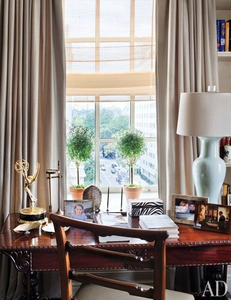 A library window affords a view of Central Park | archdigest.com