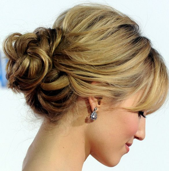 Actress Dianna Agron wears a low loose bun that would work wonderfully as a bridal updo.