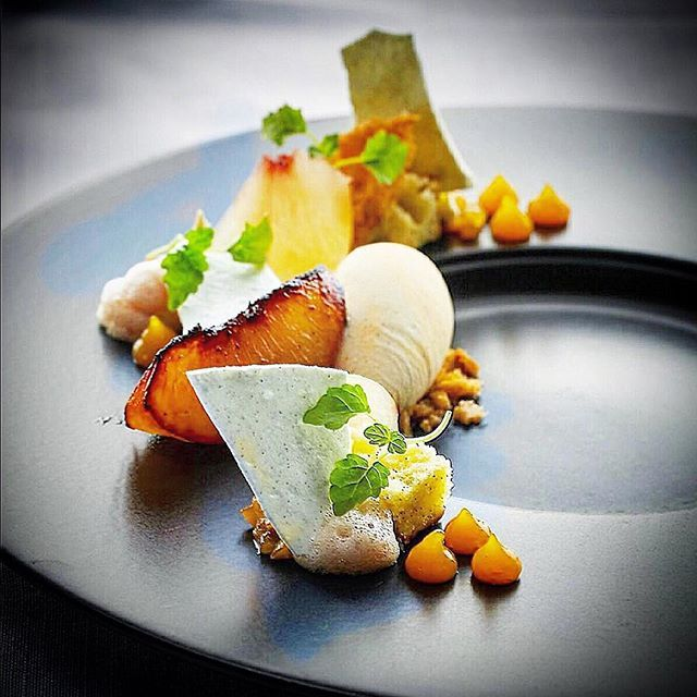 Roasted pink peach, Compressed peach, Vanilla and roasted almond ice cream, Lemon olive oil sponge, Fresh green almond, Lemon balm, Apricot gel, Lemon, verbena meringue, Apricot and champagne chutney, Almond Sable ⭐️ by Chef Kirk Westaway @chefkirk_w a member of our Cookniche Culinary Community  Join us at Cookniche.com!
