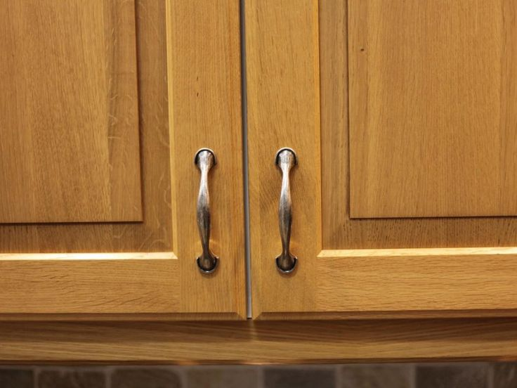 Kitchen Kitchen Cabinet Handles Which Features A Magnet For An Eclectic Kitchen With Wood Cabinets And A Vertical Pull In A Narrow Cabinet Different Basic Materials For Kitchen Cabinet Handles