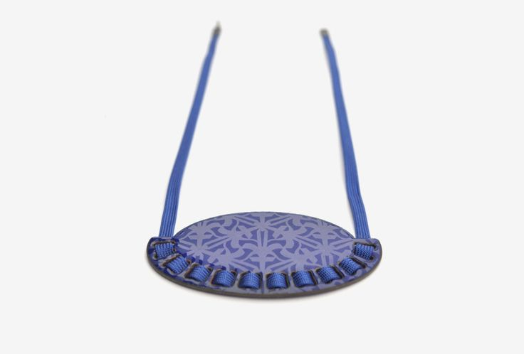 Necklace from the <em>mikromakro</em> collection. Enamel on copper, textile band and oxidized silver.