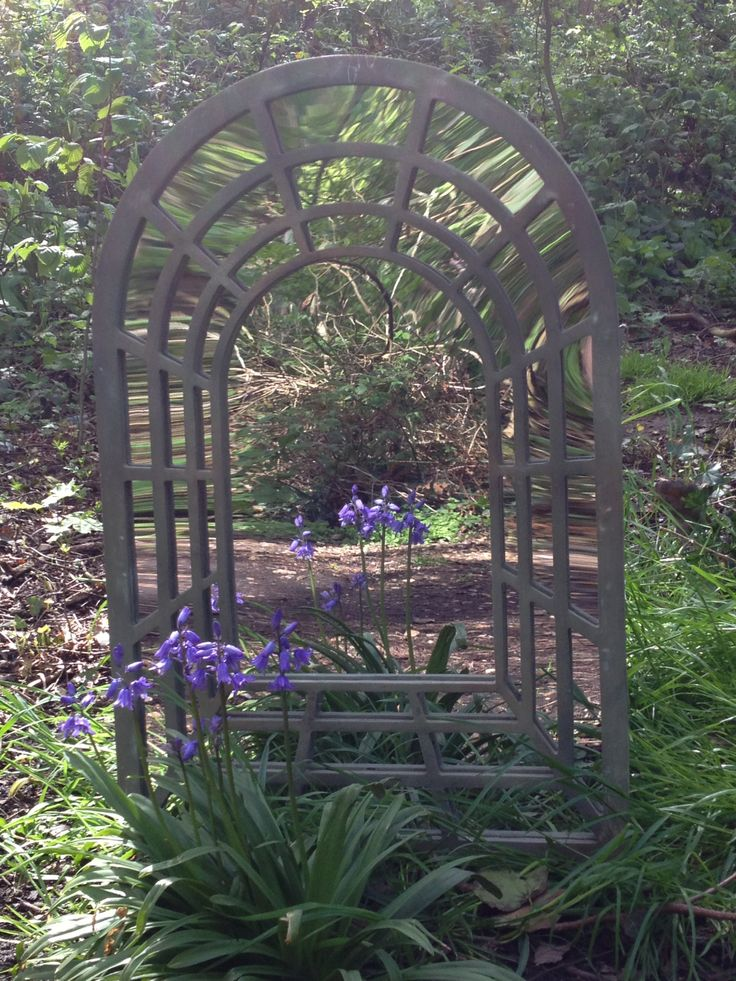 Perspective Garden Mirror - used to create the illusion of space, light, or a secret garden beyond.......