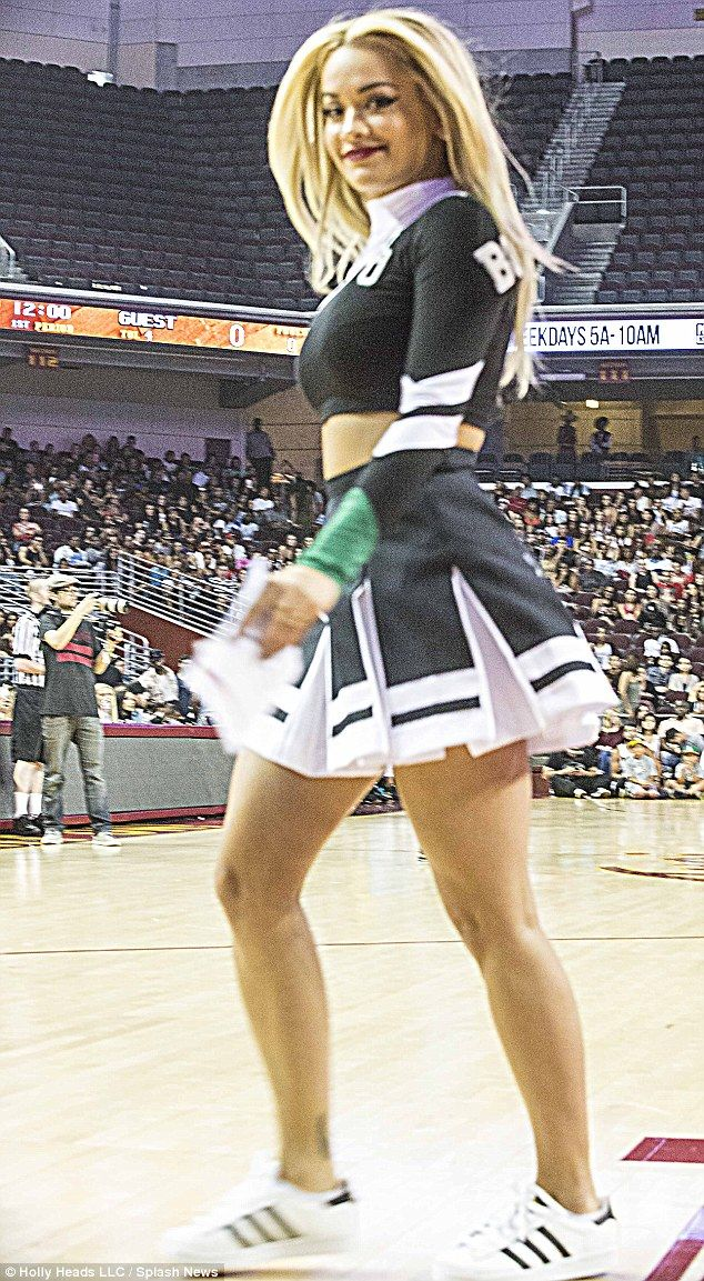 Rita Ora shows off enviable curves as she rocks cheerleading uniform #dailymail