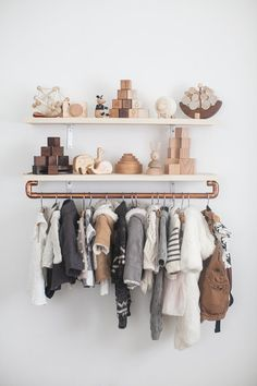 kids closet diy with floating shelves and a copper clothing rail